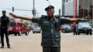 A policeman stretched his arms to stop protesters advancing to a barricade in Port Harcourt, Rivers State, on March 11, 2019.
