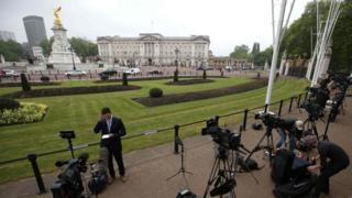 Crews outside Buckingham Palace