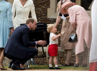 Queen Elizabeth II speaks to Prince George