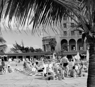 Tourists at the swimming pool of Havana's Hotel Nacional