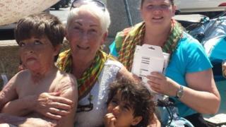 Rachel Miller with refugees in Kos