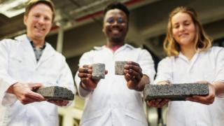 From lef: Dr Dyllon Randall and his students, Vukheta Mukhari and Suzanne Lambert holding the world's first bio-brick made using human urine