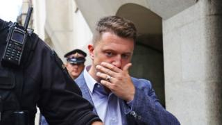 Tommy Robinson leaves court
