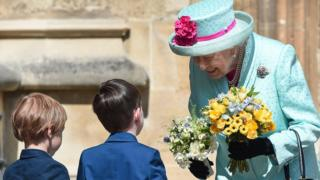 The Queen was presented with flowers as she left St George's Chapel