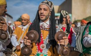 "Moroccans take part in a procession marking the 1448th anniversary of the birth of the Prophet Muhammad, at what is known in Arabic as ""the Prophet""s birthplace"" in Sale, Morroco, 19 November 2018."