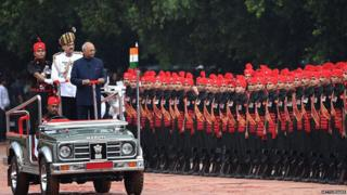 Incoming Indian president Ram Nath Kovind inspects a guard of honour during a ceremony at the Presidential Palace in New Delhi on July 25, 2017.
