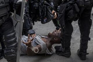 Colombian protester and police