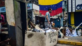A barricade set up by activists during a protest called by the opposition, in Caracas on July 29, 2017
