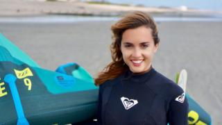 Alessandra Sollberger with kite surf equipment