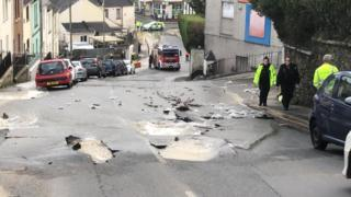 A burst water main in a street