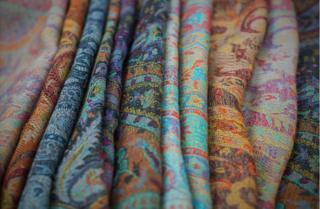 Colourful folded Pashmina shawls