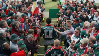 Martin Johnson walks through the fans to get to the pitch