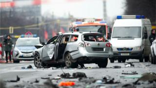 A damaged car on Bismarckstrasse in Berlin, Germany, 15 March 2016. The driver died when an explosion occurred in the vehicle while it was moving.