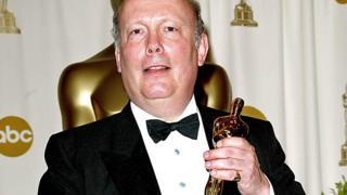 Julian Fellowes holding his Oscar