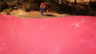 People take photographs of the pink lake at Westgate Park on March 27, 2019 in Melbourne, Australia.