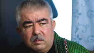 Afghan General Abdul Rashid Dostum speaks during an interview at his palace in Shibergan, in northern Afghanistan