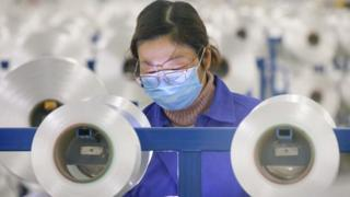 Chinese employee working in factory