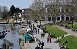People are seen relaxing along the waterfront beside the River Thames, as the number of coronavirus disease cases (COVID-19) grow around the world, Richmond, south west London