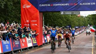Matteo Trentin of Italy celebrates as he crosses the line and wins gold in the men's road race