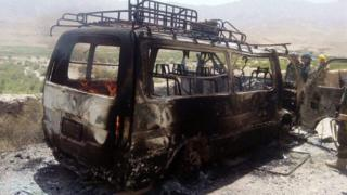 Photo showing burnt out bus in which the tourists were being taken to Herat