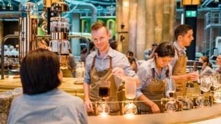 barista serving at bar, Starbucks Milan