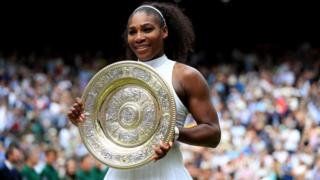 Serena Williams holding Wimbledon trophy