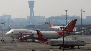 Air India airlines aircraft are parked at the Chhatrapati Shivaji International Airport in Mumbai, India,