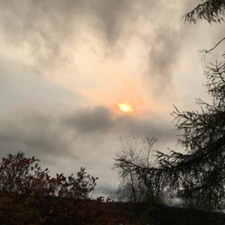 The orange sun at Dalmally bursting through a very overcast sky