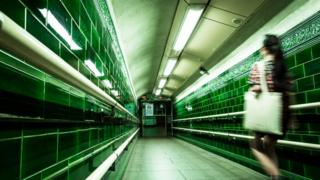 Blurred image of a woman in a deserted subway
