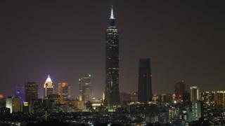 A view of the skyscaper Taipei 101 with lights-off during the Earth Hour in Taipei, Taiwan