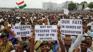 Members of the Patel community display placards as they attend a protest rally in Ahmedabad, India, August 25, 2015.