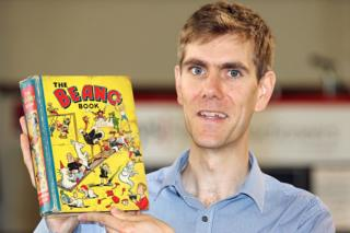 Robert Henshilwood, head of books for Keys Fine Art Auctioneers in Aylshan, with first edition Beano annual