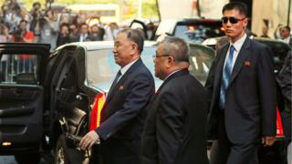 Kim Yong-chol, left, arriving at his New York hotel ahead of meeting Mike Pompeo