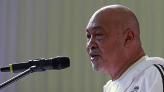 Suriname's President Desi Bouterse, addresses the public before taking part in a yoga class on the 4th International Yoga Day in Paramaribo, Suriname on June 21, 2018.