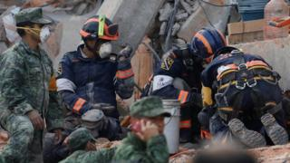 Rescue workers search through rubble of Enrique Rébsamen school - 20 September