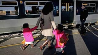 passengers board train