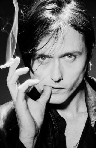positive news Brett Anderson smoking a cigarette