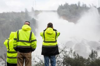 California Department of Water Resources staff monitoring the water flowing through the damaged spillway on Friday 10 February