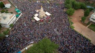 This aerial view shows Malians gathering at the Independence square in Bamako on June 5, 2020.