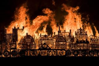 A 120-metre long model of London's 17th-century skyline burns to mark 350 years since the Great Fire