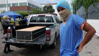 in_pictures Man in protective kit to identify a relative in a morgue, Guayaquil, 15 Apr 20