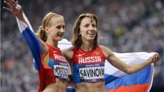 Russian athletes Mariya Savinova (R) and Ekaterina Poistogova came first and third in 800m final at London 2012 Olympics