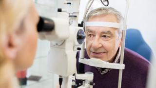 Optician examining patient