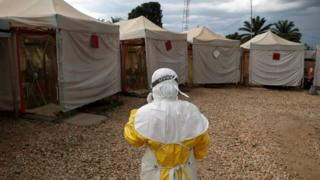 One medical worker wey wears Ebola protection gear