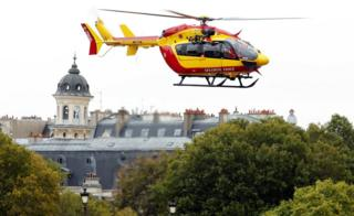 A rescue helicopter is seen after an attack on the police headquarters in Paris.