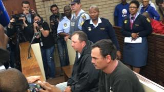 Theo Martins (L) and Willem Oosthuizen in court