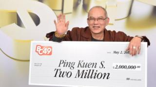 Ping Kuen with his cheque