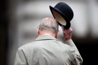 Prince Philip, Duke of Edinburgh raises his hat in his role as Captain General.