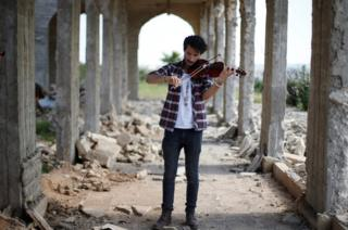 Ameen Mukdad, a violinist from Mosul
