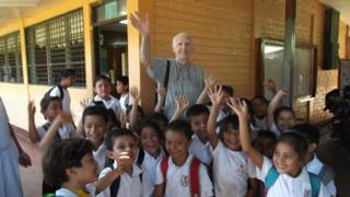 Fernando Cardenal with schoolchildren